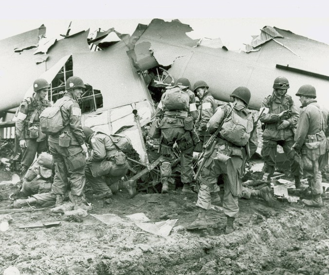 101st Airborne Division troops that landed behind German lines in Holland examine what is left of one of the gliders