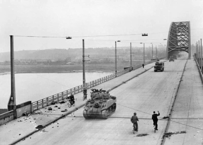 Allied tanks of British XXX Corps cross the road bridge at Nijmegen