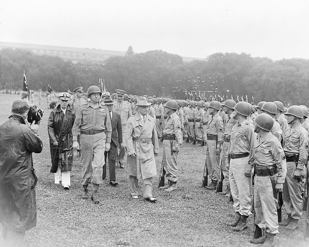 President Truman walking past members of the Nisei 442nd Regimental Combat Team as they stand at attention on the Ellipse., 15 July 1946